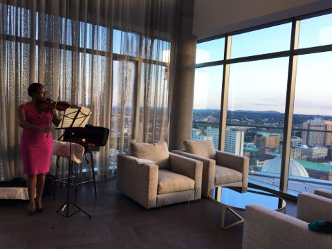 Monique Smith, a violinist from the Berklee School of Music entertained guests with classical music.